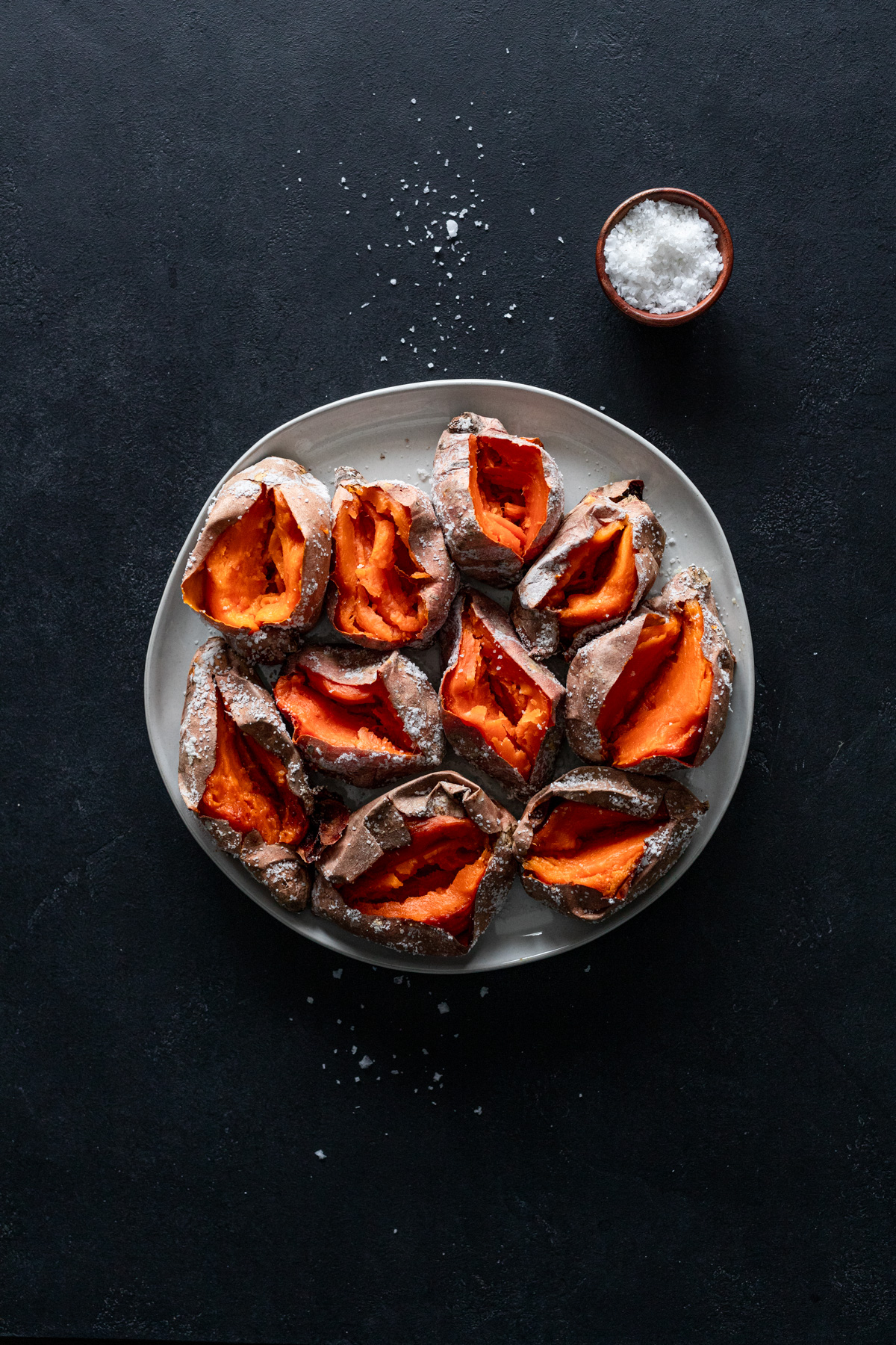 salt roasted sweet potatoes recipe on a platter before adding sauce