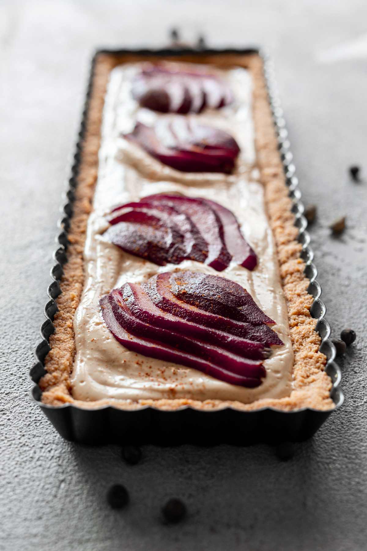 fall-spiced vegan tart with poached pears on top