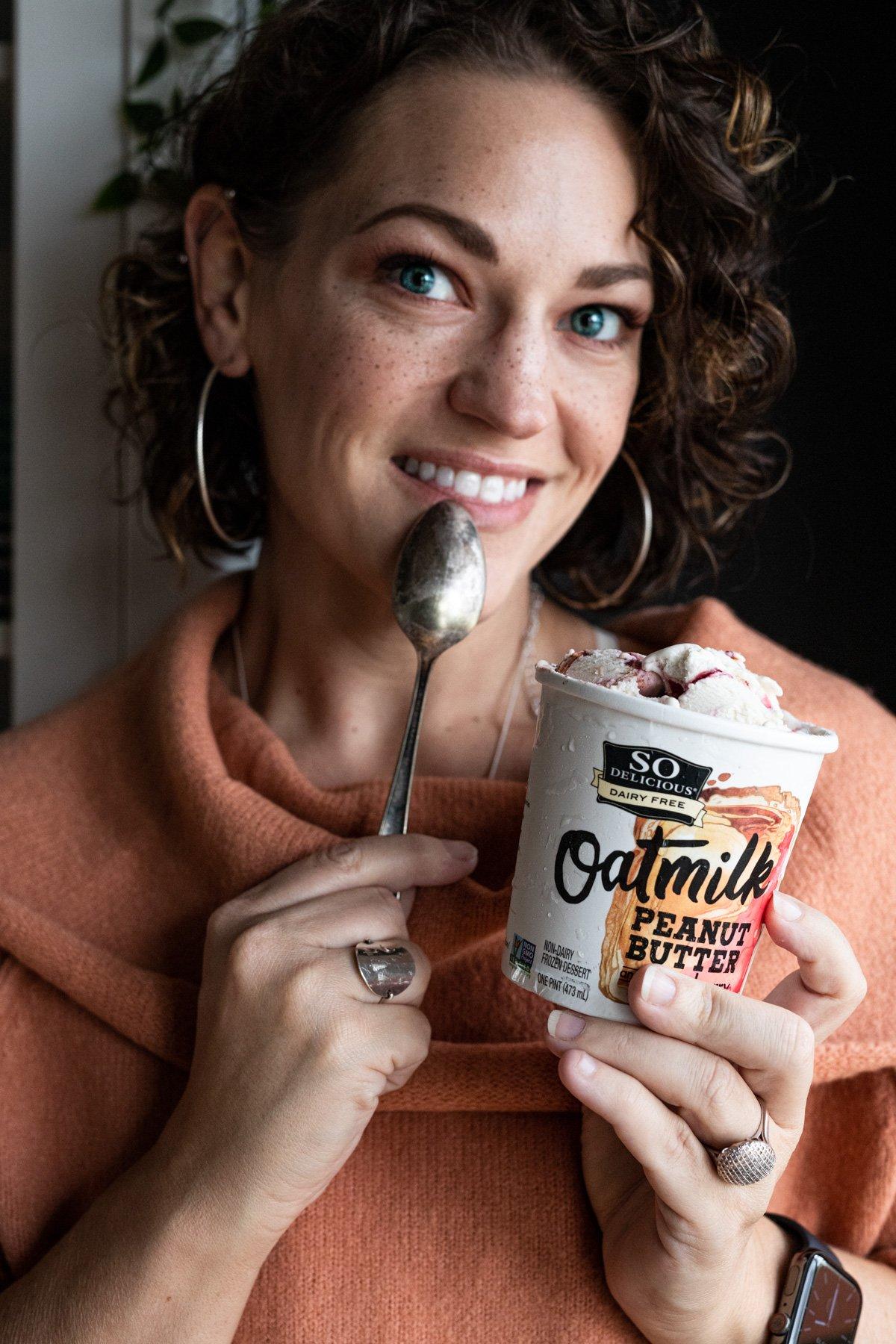 karly gomez enjoying a pint of So Delicious Dairy Free frozen dessert