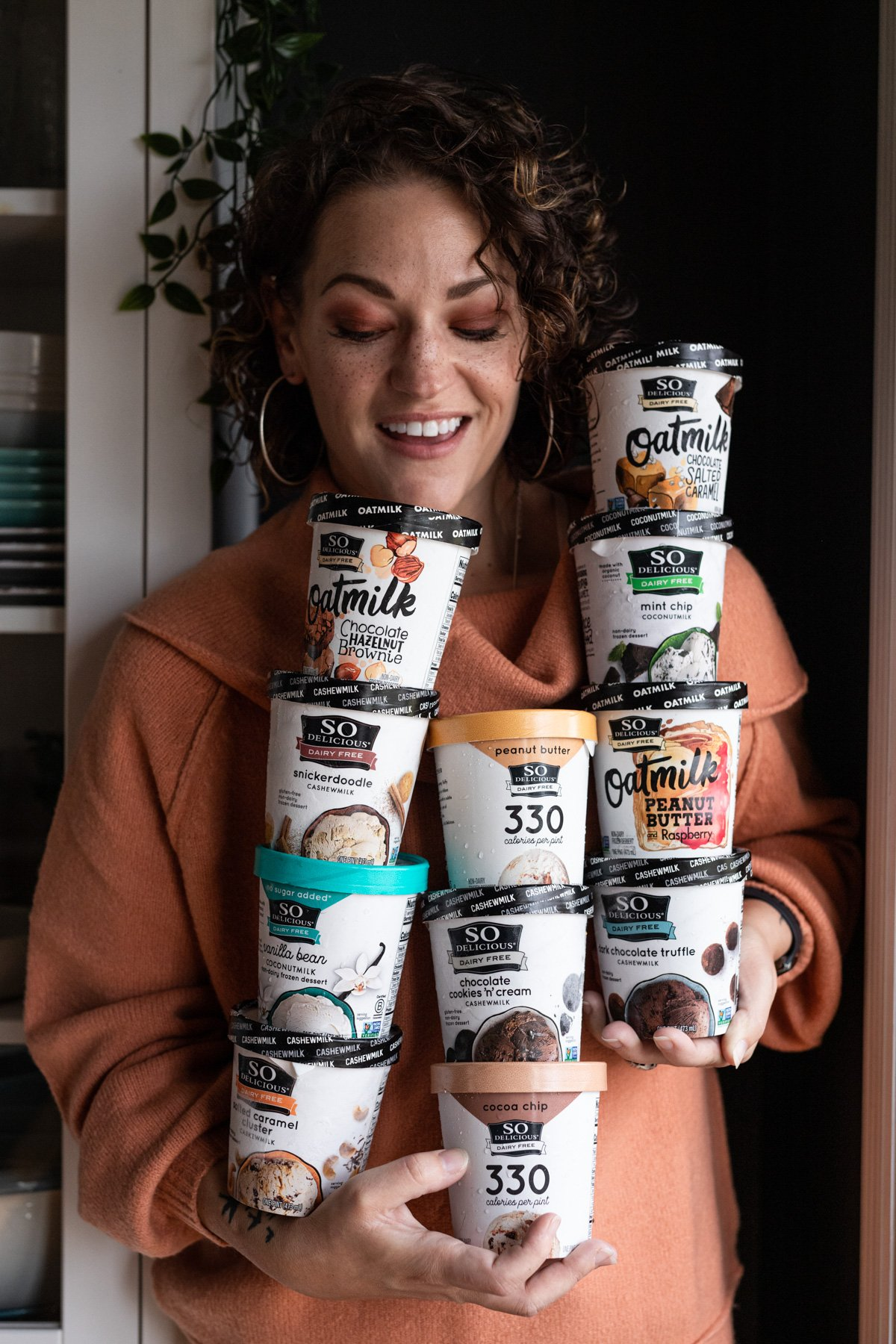 karly gomez holding 11 pints of so delicious dairy free frozen dessert