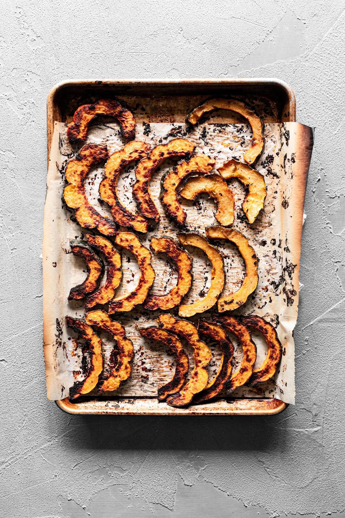 sheet pan with roasted acorn squash with maple tahini marinade