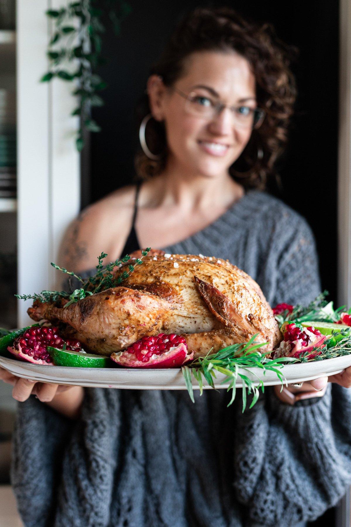 karly gomez holding za'atar dijon smoked turkey on a platter